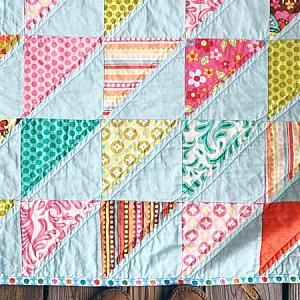 Crib Quilt, southeastern triangles on aqua